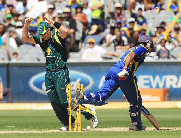 Daniel Christian of Australia celebrates as a direct hit from team mate David Hussey runs out Mahela Jayawardene