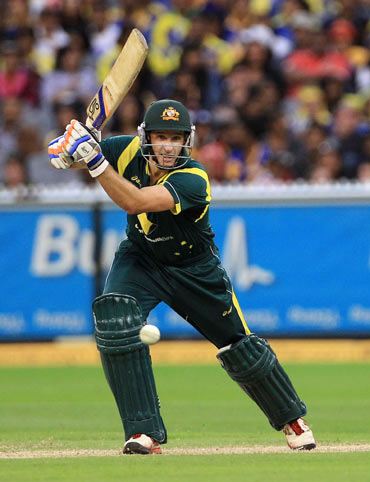 Michael Hussey of Australia drives during the One Day International match between Australia and Sri Lanka at Melbourne Cricket Ground