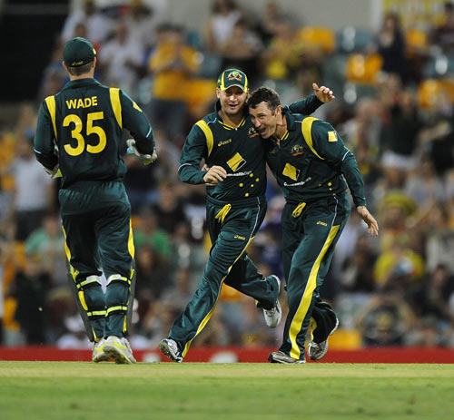 David Hussey celebrates after picking up a wicket