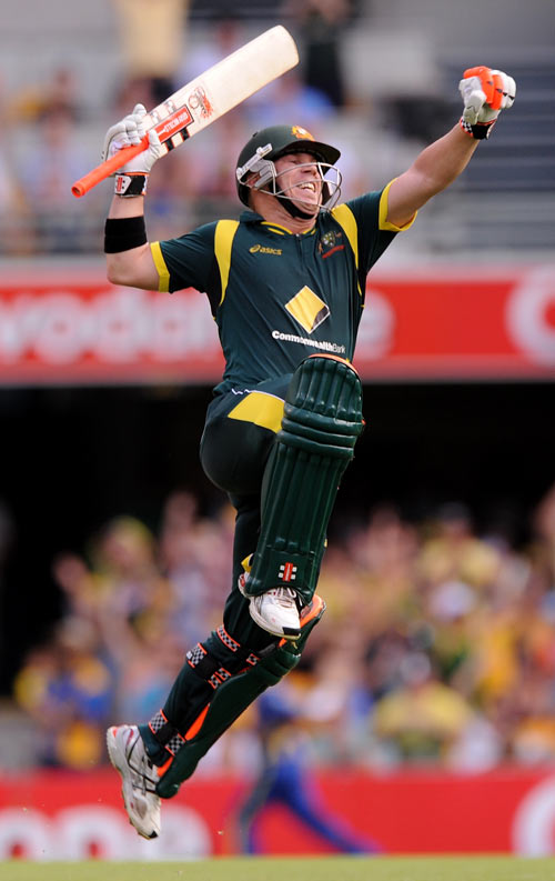 David Warner celebrates after completing his century