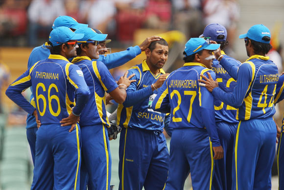 Tillakaratne Dilshan of Sri Lanka is congratulated by his team mates after taking the wicket of Matthew Wade of Australia during the second One Day International Final