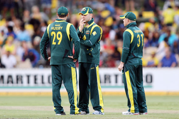 David Hussey, Michael Clarke and David Warner of Australia talk between overs during the second One Day International Final series match