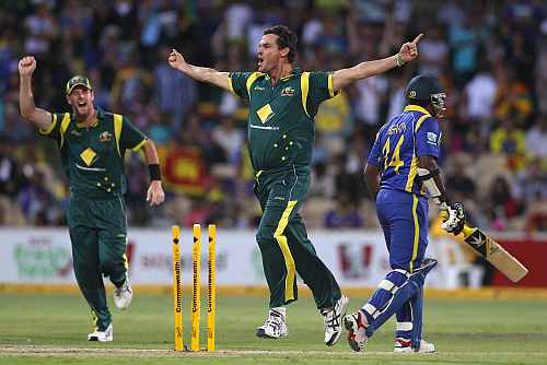 Clint McKay celebrates after picking up a wicket