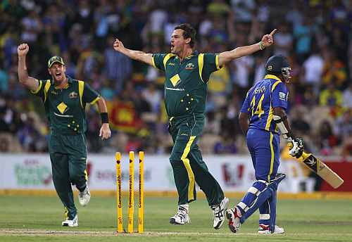 Clint McKay celebrates after picking up a wicket against Sri Lanka