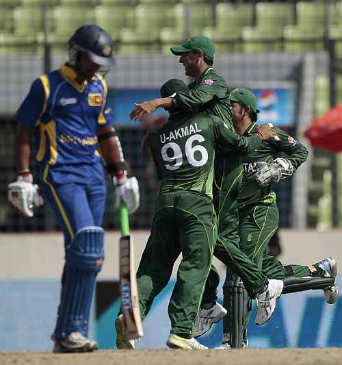 Pakistan players celebrate after the dismissal of Dinesh Chandimal