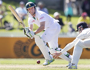 South Africa's AB de Villiers plays a shot past Kane Williamson of New Zealand on day two of the second Test match in Hamilton on Friday
