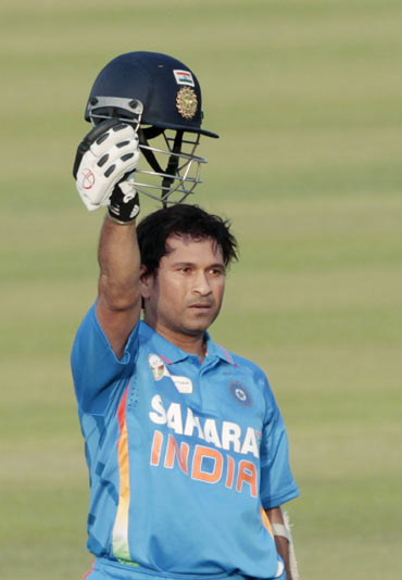 India's Sachin Tendulkar celebrates after he scored his 100th international century during their Asia Cup one- day international (ODI) cricket match against Bangladesh in Dhaka