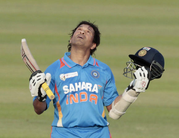 India's Sachin Tendulkar celebrates after he scored his 100th international centuries during their Asia Cup One Day International (ODI) cricket match against Bangladesh in Dhaka