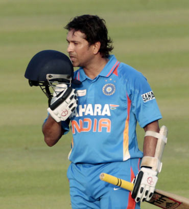 India's Sachin Tendulkar celebrates after he scored his 100th international centuries during their Asia Cup one- day international (ODI) cricket match against Bangladesh in Dhaka