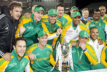 South Africa players celebrate winning the ODI series against New Zealand, in Auckland on March 3