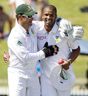 South Africa's Vernon Philander (right) is congratulated by teammate Mark Boucher after taking 10 wickets in the match on day three of the second Test against New Zealand in Hamilton on Saturday