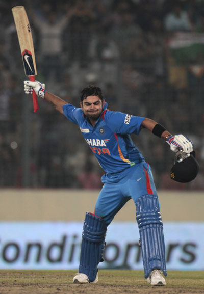 Virat Kohli celebrates after completing his century against Pakistan