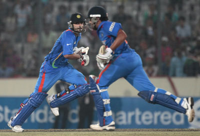 Virat Kohli and Rohit Sharma run in between wickets during their match against Pakistan