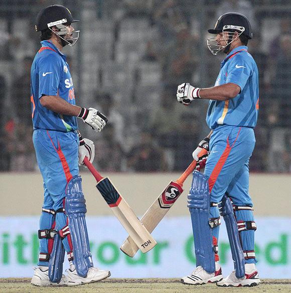 Virat Kohli (left) with Suresh Raina