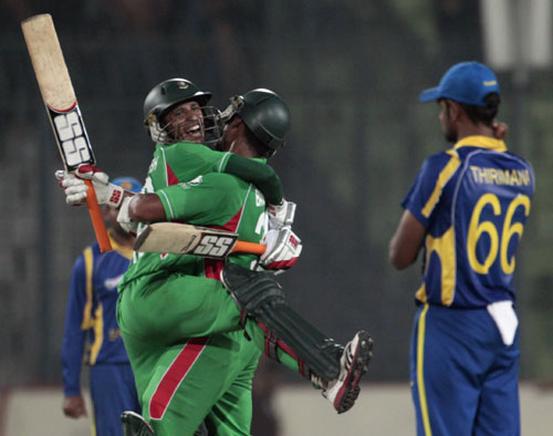 Bangladesh's Nasir Hossain and Mahmudullah celebrate after winning their match against Sri Lanka in Mirpur