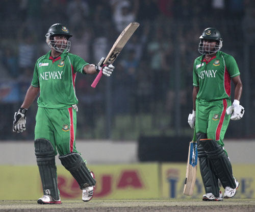 Bangladesh's Tamim Iqbal celebrates his half century as Shakib al Hasan looks on