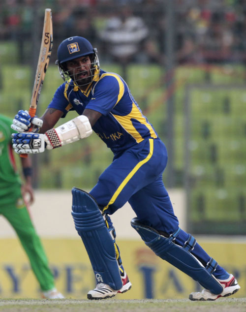 Chamara Kapugedara plays a shot during his knock against Bangladesh