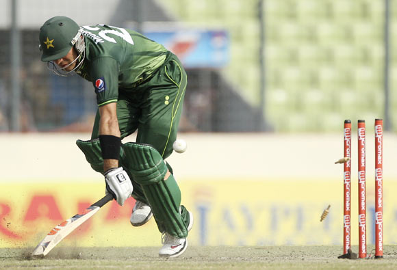 Pakistan's captain Misbah-ul-Haq is run out against Bangladesh