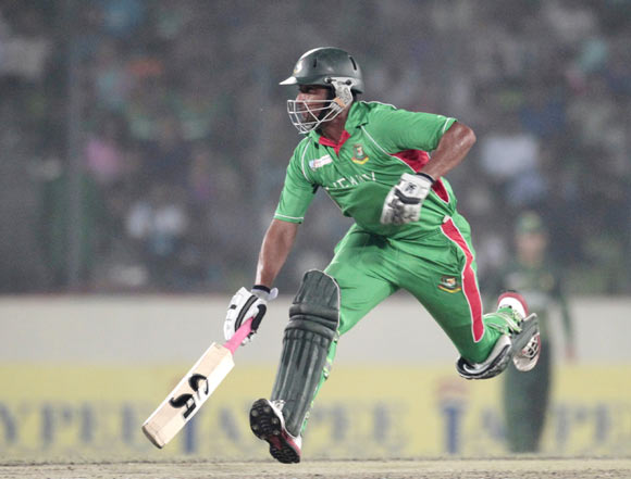 Bangladesh's Tamim Iqbal runs between the wicket against Pakistan during the final match of Asia Cup