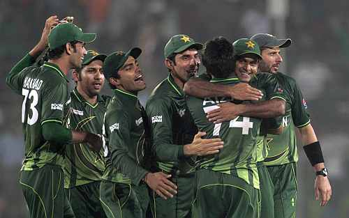 Pakistan's cricket team celebrate after they won the final match against Bangladesh at the Asia Cup Tournament