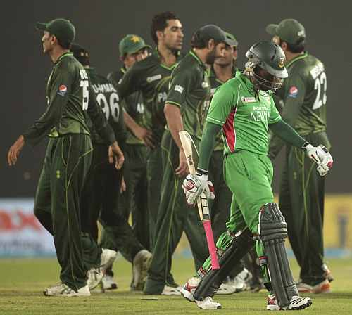Bangladesh's captain Mushfiqur Rahim leaves the field as Pakistan's fielders celebrate his dismissal