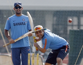 Dhoni watches Sehwag bat in the nets