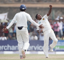 Rangara Herath celebrates taking the wicket of Graeme Swann during day 4