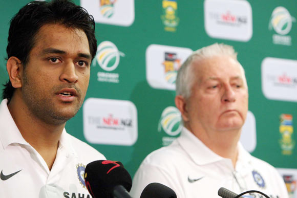 Captain MS Dhoni of India speaks beside coach Duncan Fletcher during a press conference at ACSA Media Centre