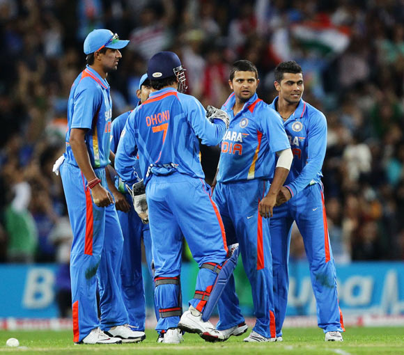 Suresh Raina (C) of India is swamped by team mates after his good fielding