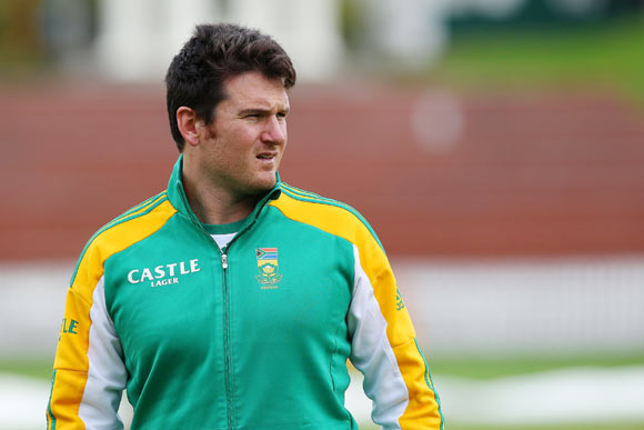 Captain Graeme Smith looks on