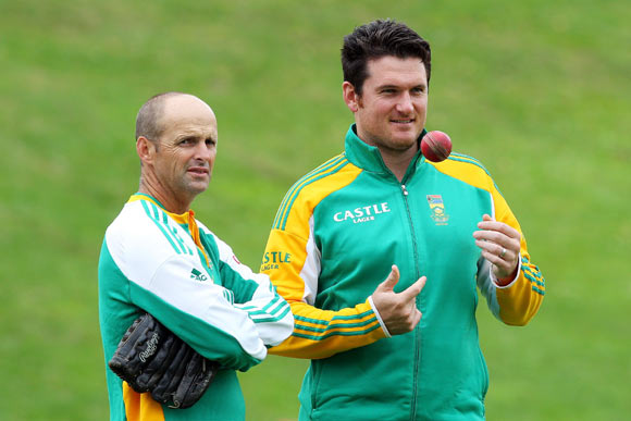 Coach Gary Kirsten (L) and captain Graeme Smith of South Africa look on during day two of the Third Test match between New Zealand and South Africa at Basin Reserve