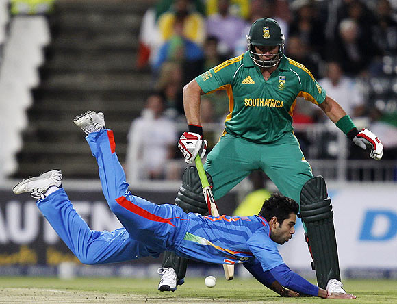 South Africa's Jacques Kallis (back) looks on as India's vice captain Virat Kohli misses a catch during their one-off Twenty20 international cricket match in Johannesburg on Friday