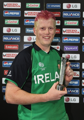 Kevin O'Brien of Ireland poses with the man of the match trophy after Ireland shocked England in the World Cup