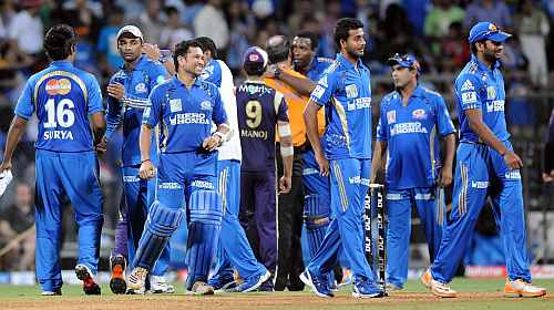Mumbai Indians players celebrate after winning a game