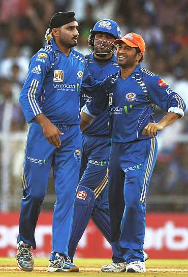 Mumbai Indians' Harbhajan Singh with Sachin Tendulkar