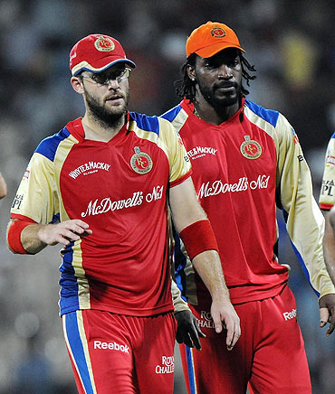 RCB's Daniel Vettori with teammate Chris Gayle