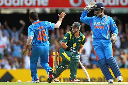 Suresh Raina, Mike Hussey and MS Dhoni