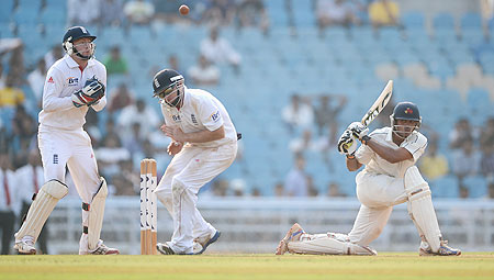 Hiken Shah of Mumbai A strikes the ball past Ian Bell and Jonathan Bairstow of England