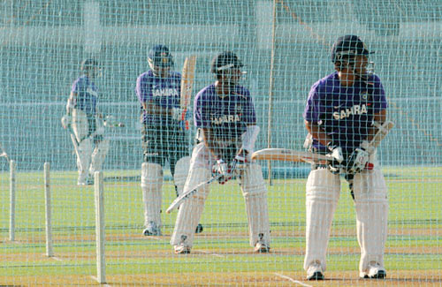 Sachin Tendulkar, Cheteshwar Pujara and Virender Sehwag bat in the nets during Friday's practice session at the Brabourne stadium