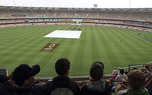 The pitch area is covered as it rains on the second day of the first Test between South Africa and Australia at the Gabba in Brisbane on Saturday