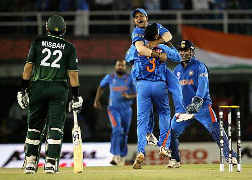 Indian players celebrate after winning the match