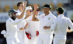South Africa's Morne Morkel (2nd from left) celebrates with teammates after the dismissal of Australia's Ricky Ponting during the first Test at the Gabba in Brisbane on Sunday