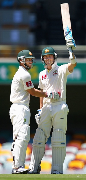 Michael Clarke is congratulated by Matthew Wade after getting to 250