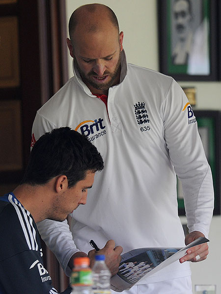 Matt Prior of England (right) gets a picture signed by teammate Steve Finn