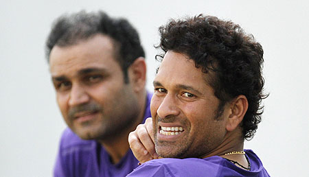 India's Sachin Tendulkar (right) and Virender Sehwag watch during a practice session in Ahmedabad on Tuesday