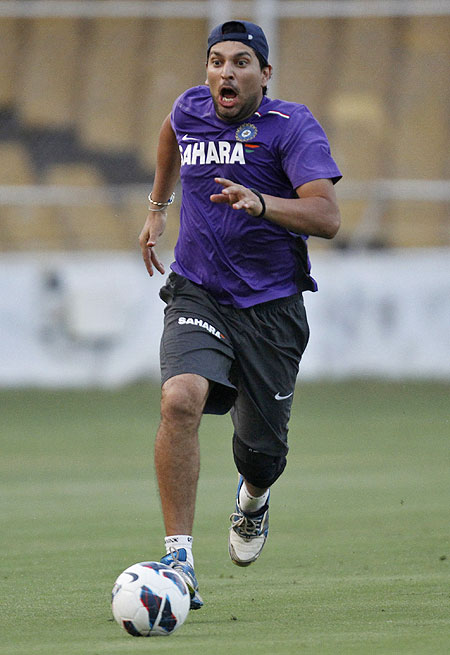 India's Yuvraj Singh plays with a soccer ball during a practice session on Tuesday
