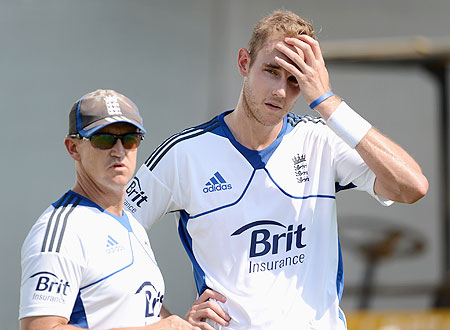 Stuart Broad speaks with coach Andy Flower during a nets session at Sardar Patel Stadium