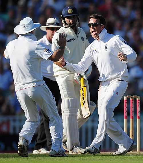 Graeme Swann celebrates the fall of a wicket during India's tour to England
