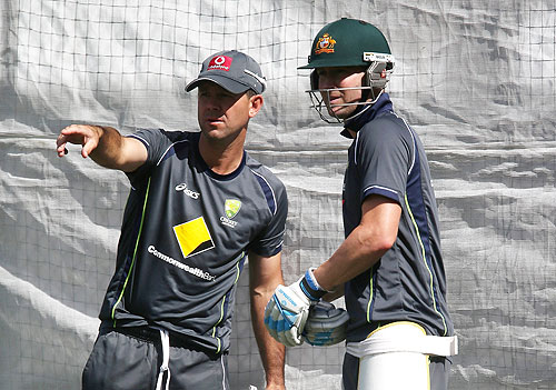 Ricky Ponting and Michael Clarke get into