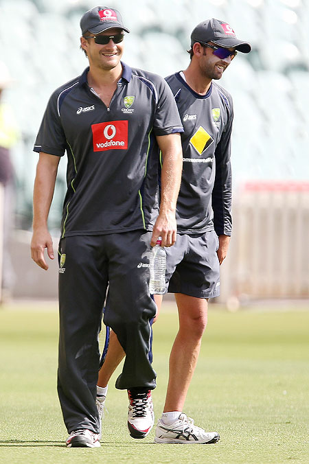 Shane Watson and Nathan Lyon smile during a training session at Adelaide Oval on Tuesday